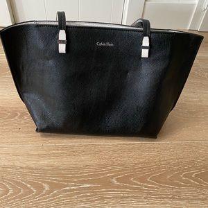 Calvin Klein zip tote pebble leather black white